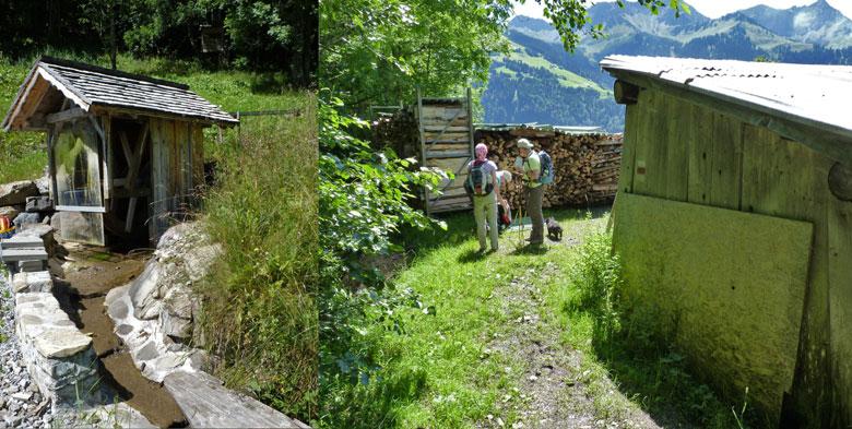 een waterrad in een houten huisje en enkele oude schuren waar we tussendoor moeten lopen